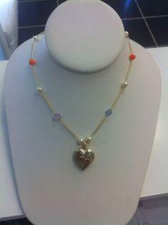 cadena oro laminado con piedras.