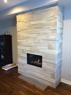 NEW ErthCOVERINGS Large Format Silver Fox Strips bump out fireplace, installed by Goodfella Stone.