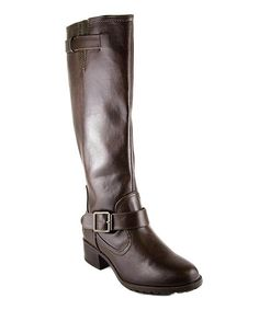 This stylish staple steps it up with a trendy look. The everyday silhouette features buckle details and a modest heel for a super-stylish finish.2'' heel15'' shaft14'' circumferenceZipper closurePull-onMan-made