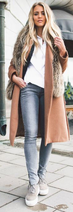 Janni Deler + cute faux fur scarf + classy winter overcoat + skinny denim jeans + a touch of fur    Jacket: Make Way, Scarf: Primark, Shirt: Lindex, Jeans: Anine Bing, Shoes: Jennie Ellen.