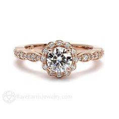Une belle Moissanite et naturel bague en diamant dans votre choix de 14K blanc, jaune ou en or Rose. La pierre centrale est quun toujours un Moissanite, équivalent en taille à un diamant carat.75 ronds mousseux. Il est entouré par un halo de diamants naturels et ils continuent sur la bande