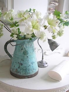 Flowers in a pretty blue pitcher.