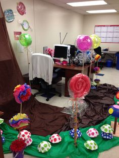 Decorating for a coworker's birthday the theme is Charlie and the chocolate factory in the waterfall room