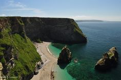 The beach of Western Cove, Portreath, Cornwall; the beach is only accessible by sea.