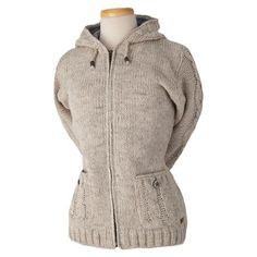 The Laundromat women's Kelly sweater is a simple, elegant hooded sweater. They have a hand knit exterior with elegant cable knit designs on the sleeves, hood, and pockets that give it a really classic, fashionable look. Each of the three colorways are solid colors which really draw your eyes to the detailed knitting and hand carved buttons that adorn the two hand pockets on this hooded sweater. We love the distinctly winter styling of this sweater.