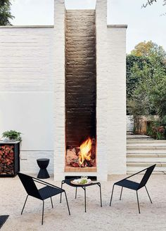 modern back patio design with mid century modern outdoor furniture modern outdoor seating area with gravel and modern outdoor fireplace painted white brick home exterior Rustic Outdoor Fireplaces, Outdoor Fireplace Designs, Backyard Fireplace, Fire Pit Backyard, Backyard Patio, Backyard Seating, Backyard Landscaping, Pergola Patio, Brick Fireplace