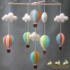 Had to pin bc this is what lovelysymphony made for Walter's nursery only in different colors. Love it!!!    hot air balloons baby mobile by LovelySymphony on etsy.