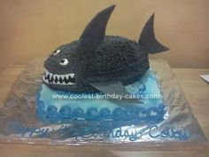 Homemade 3D Shark Cake: I had a request for a '3D' shark cake for a cousin's 4th birthday. This was made with the Wilton football and a regular 13x9 pan. The shark is 2 football