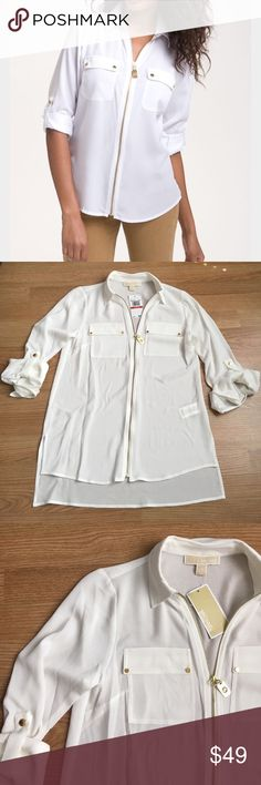 MK zip safari shirt Relaxed silhouette. Spread collar. Long sleeves with snap tabs. Flap chest pockets. Logo dog-tag pull at zippered front. High-low shirttail hemline. 100% polyester. Machine wash cold, tumble dry.        It's a loose fit XS. I normally wear a small and this fits me loose as well. Michael Kors Tops Blouses