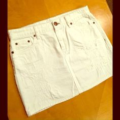 J. Crew Distressed White Denim Mini Naturally-distressed white denim mini skirt from J. Crew; size 6. Worn once; excellent condition. J. Crew Skirts Mini