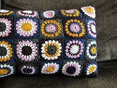 Sunburst Flower Granny Square Cushion hand crocheted by NikkiBag (a lovely German Blog)   You can find the free pattern for the Sunburst Flower Granny Square here on Ravelry.  I think Nikki has used such fabulous colours in this project!  Note to self - remember this colour mix …