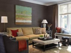i heart everything! furniture and the art above the sofa. the enameled wainscot paneling below the dark walls is really a sharp look/