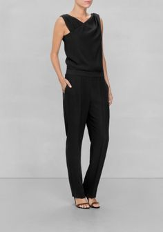 The feminine surplice bodice and the smartly tailored trousers charm this  dapper jumpsuit that takes day 24f1271678