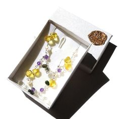 No more dull winter hues. This yellow cubic zirconia, purple amethyst, deep green tourmaline, pearl and quartz jewellery set is the colourful, cool way to embellish; Gemstones, Sterling Silver, Earrings & Bracelet, Jewellery / Jewelry Set, Canary Yellow, Cubic Zirconia, Quartz, Amethyst, Tourmaline, Pearl.