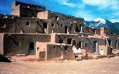 The adobe dwellings and ceremonial buildings of Taos Pueblo are standing testaments to the enduring culture of a group established in the late 13th and early 14th centuries. Situated in the valley of a small tributary of the Rio Grande, the adobe settlement represents the culture of the Pueblo Indians of Arizona and New Mexico. Photo by NPS.