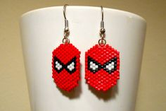 These earrings are an awesome way to show your love for Spiderman! They are bead woven with red, black, and white Size 11 Delica beads. The design
