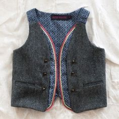 Though it's listed in the Girls section, this stunning vest is definitely in the unisex realm. Oh, the styling possibilities!