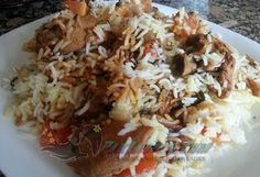 How to Make Reshmi Biryani:  Chicken – 1kg Papaya paste – 1 tbsp Fried onion – 1 cup Salt – 1 1/2 tsp Red chili powder – 3 tsp Ginger garlic paste – 2 tbsp Coriander powder – 2 tsp Garam masala powder – 1 tsp Yogurt – 375gm Rice – 750gm Bay leaf – 1 Black cumin seeds – 1/2 tsp Cinnamon stick – 1 Cloves – 3 Black pepper – 6 Green cardamom – 4 Oil – 1/2 cup Whole green chili – 5 Potato – 4 fried