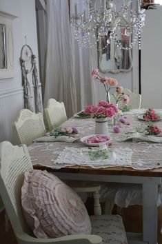 fresh garden roses and lovely lace table setting