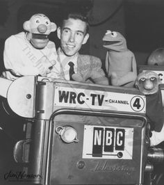 Jim Henson with the original Kermit and other Muppets from his first show.