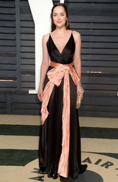 1cfcdc2ed5e Dakota Johnson wearing Gucci gown to the 2017 Vanity Fair Oscar Party  Hosted by Graydon Carter at the Wallis Annenberg Center for the Performing  Arts on ...