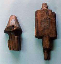 Carved wooden pieces of unknown use. These pieces were likely some sort of ship fittings. There is evidence that a substantial amount of woodworking and carpentry was conducted at L'Anse aux Meadows, Newfoundland, Canada during the Viking era.