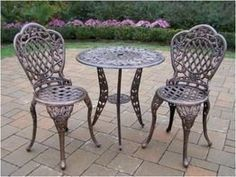 Oakland Living 3005-AB Rose ThreePiece Outdoor Bistro Set by Oakland Living. $323.98. Fade, chip and crack resistant. Easy to follow assembly instructions and product care information. Made of Rust Free Cast Aluminum Construction. Stainless steel or brass assembly hardware. Set includes Bistro Table w Umbrella Opening and 2 Bistro Chairs. Finish:Antique Bronze Tea Rose Three-Piece Bistro Set The Oakland Tea Rose collection is perfect for flower lovers. Each piece i...