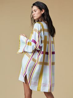 Effortless and endlessly elegant, this 100% silk, button-down, long sleeve, oversized-style shirt dress features a hidden button closure, two-button cuffs, an understated mandarin collar, and two side slits along the seams that underscore the appealing fluidity of the dress.