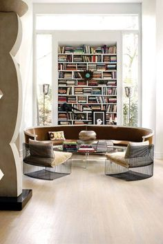 round couch, bookshelves, those chairs...