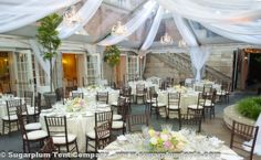 This clear tent has beautiful swagging in a sheer white fabric. The crystal chandeliers complete the elegant and sophisticated ambiance. It was installed at the Dumbarton House in Washington, D.C.