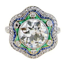 Charming Antique Diamond, Emerald & Sapphire Handmade Ring | From a unique collection of vintage engagement rings at https://www.1stdibs.com/jewelry/rings/engagement-rings/