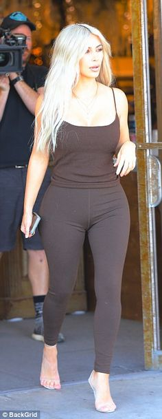 Stunner: The 36-year-old star flaunted her hourglass figure in chocolate colored leggings with a matching tank top for shopping in the LA area neighborhood