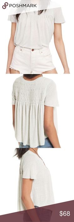 Free People T - Shirt This shirt from Free People would look cute with your favorite pair of jeans or cut off shorts. The material is 70% rayon/30% linen. It features a crew neck, smocked chest and short sleeves. The color is sky. Free People Tops Tees - Short Sleeve