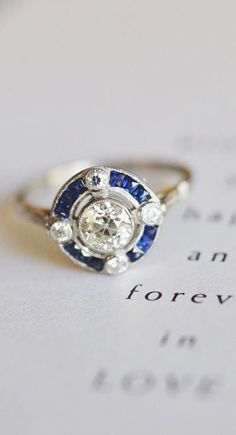 Love the antique feel of this unique sapphire engagement ring.