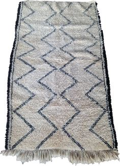 Beni Ouarain with black border  200 x 123cm  This Beni Ouarain has a traditional pattern of zig zags with a black border down the long sides. It has tassels on one end and is woven on the other, as is usual with this type of rug. Being double knotted it is very thick and warm under foot.  100% wool Long Sides, Types Of Rugs, Zig Zag, Knots, Tassels, Warm, Traditional, Pattern, Black