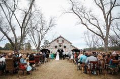 Hadley and Kodi's Vintage Rustic Georgia Outdoor Wedding in front of the barn at Fritz Farm. TR Photography