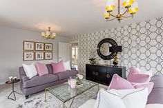 The main living room has comfy set of sofas with beautiful interior design. The beauty of this room is that is decorated with a colour theme of blush, purple, white and creams.
