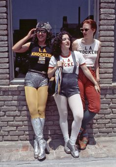Three girls wearing yellow, white and greyish blue pantyhose + L.A. Knockers t-shirts