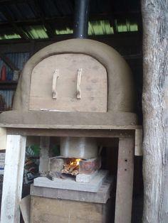 Rocket Oven - A hybrid of a rocket stove and a cob oven. 100 process pics.