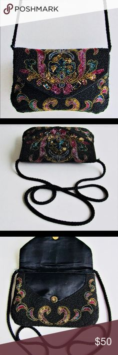 """Lillian Vernon vintage glass beaded evening Purse Beautiful glass beaded floral evening Purse.  Black micro bead body embellished with emerald, ruby, & gold tone glass bead pattern  Envelope front flap with magnetic snap closure Black 19.5"""" drop braided rope strap, carry as a clutch, cross-body, or shoulder bag Roomy odor free interior compartment lined in spotless silky black fabric Inside rear sidewall slip pocket lillian Vernon Bags Clutches & Wristlets"""