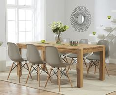 Buy the Verona Solid Oak Dining Table with Charles Eames Style DSW Eiffel Chairs at Oak Furniture Superstore Oak Extending Dining Table, Solid Oak Dining Table, Oak Table, Extendable Dining Table, Table And Chairs, Side Chairs, Desk Chairs, Metal Chairs, Dining Tables