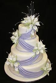 Like the asymmetrical ribbon w/ flowers...reminds me of my wedding dress!