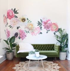Pink and white Pastel vinyl flowers wall decals on a white wall creating a flower wallpaper effect. Each floral features graphic like detail with and a variety of white and pink shades with a hint of green in the leaves.