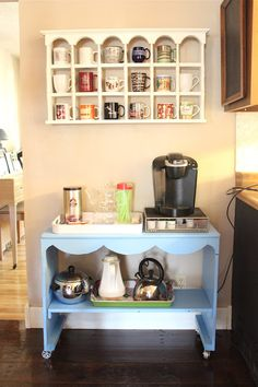 I love how the mugs are displayed in the shelf unit.  I am so gonna paint mine white!