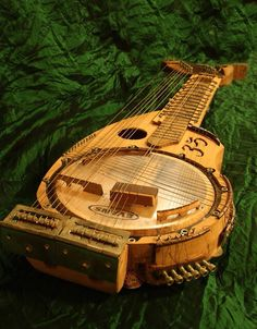 Harp Guitars - DIZZY STRINGS Barp Banjo Harp Guitar, with raised frets (like a sitar) and banjo drum resonator Wtf is this and where can I play one? Cigar Box Guitar, Music Guitar, Art Music, Acoustic Guitar, Guitar Pics, Unique Guitars, Custom Guitars, Mountain Dulcimer, Mandolin