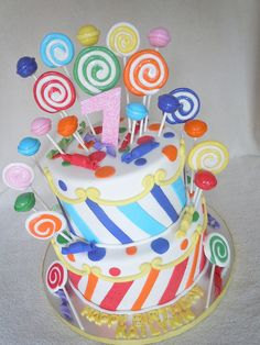 I like the scrolls used to camouflage the seams between the striped and dotted parts of the fondant