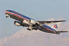 A picture of an American Airlines Boeing 777-223(ER) airplane climbing after take off from Los Angeles (LAX/KLAX). The aircraft registration is N771AN