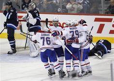 Montreal Canadiens' P.K. Subban (76), Max Pacioretty (67), Andrei Markov (79), Brendan Gallagher (11) and David Desharnais (51) celebrate Desharnais' goal on the Winnipeg Jets goaltender Ondrej Pavelec (31), Ron Hainsey (6) and Mark Stuart (5) during third-period NHL hockey game action in Winnipeg, Manitoba, Thursday, April 25, 2013