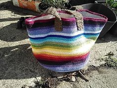 This bucket bag is perfect for using up all your little odds and ends, and features a crocheted lining which fits perfectly inside the bag… no fussing around with fabric needed!