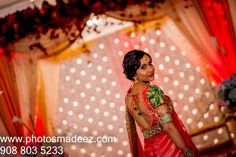 Bride in front of Mandap at a Hindu Wedding. Decor by Ravi Verma in Gujarati Wedding in Wedding in the Skylands, Nj. Gujarati Wedding. Bridal Makeup by Cinderella Bridez. Best Wedding Photographer PhotosMadeEz, Award winning photographer Mou Mukherjee.